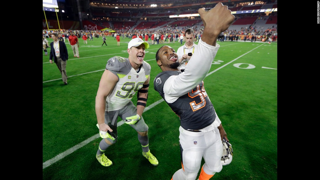 Houston Texans defensive end J.J. Watt hams it up in a selfie taken by the St. Louis Rams' Robert Quinn at the end of the Pro Bowl on Sunday, January 25. The NFL's annual all-star game was played in Glendale, Arizona.