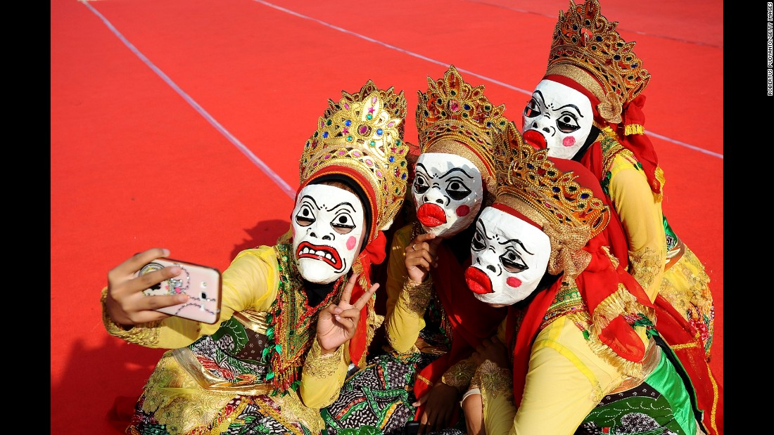 Muslim girls in Surabaya, Indonesia, take selfies during the Mawlid Mask Festival, which commemorated the birthday of the Prophet Mohammad on Sunday, January 25.