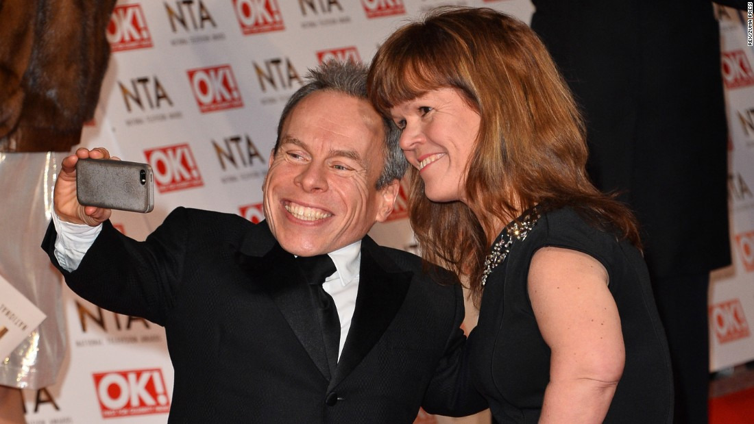 Actor Warwick Davis and his wife, Samantha, take a photo on the red carpet Wednesday, January 21, as they arrive for the National Television Awards in London.