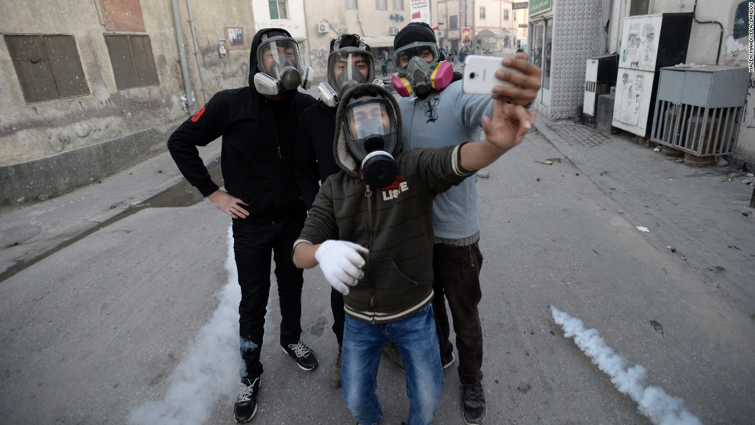 Protesters wear gas masks as tear gas rounds fly by them during clashes in Manama, Bahrain, on Thursday, January 22. People have been demonstrating against the arrest of Sheikh Ali Salman, leader of the banned Shiite opposition movement Al-Wefaq.
