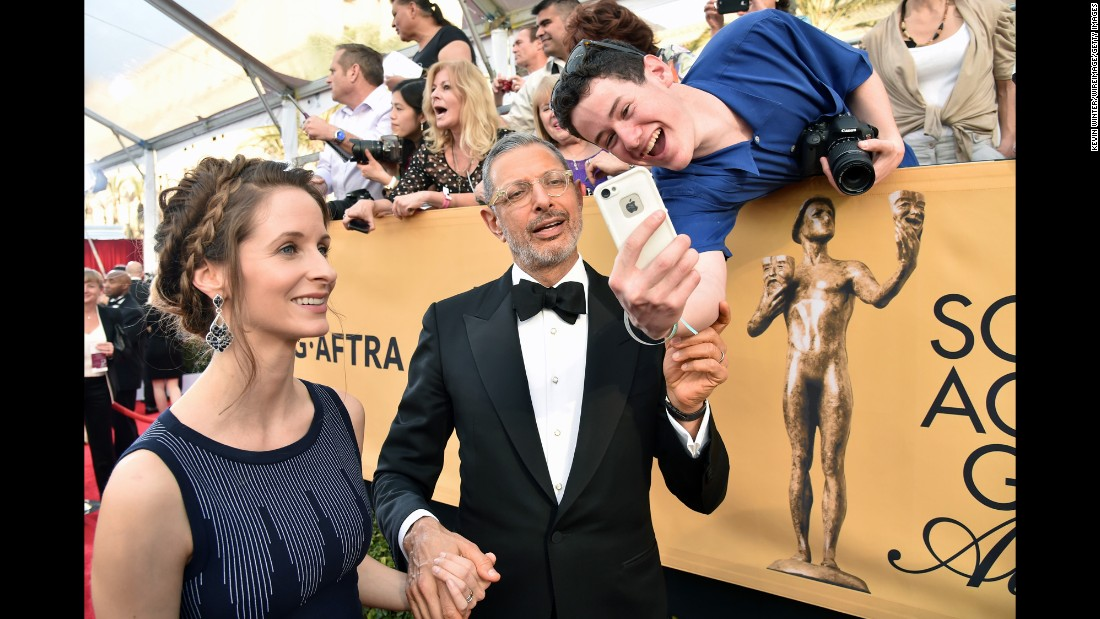 Actor Jeff Goldblum takes a photo with a fan after arriving for the Screen Actors Guild Awards, which were held in Los Angeles on Sunday, January 25.