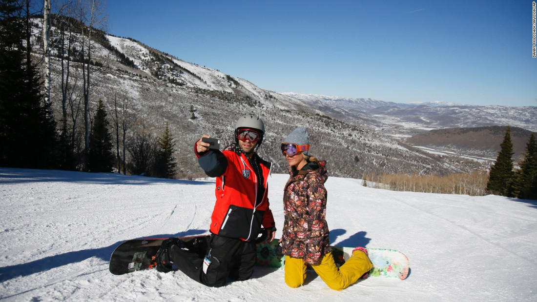 Actor Adrian Grenier snaps a photo with longtime friend Leland Drummond while they snowboard together Monday, January 26, in Park City, Utah. Park City hosts the annual Sundance Film Festival.