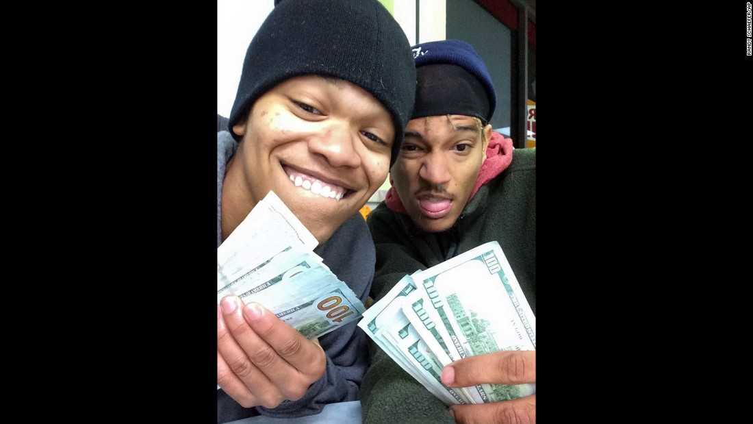 Dorian Walker-Gaines, left, and Dillan Thompson were arrested and charged with theft on Wednesday, January 21, after investigators in Houston used this selfie to track them down. The photo was taken on the stolen iPad of Randy Schaefer, who said his iPad was taken from his truck -- along with thousands of dollars and other electronics -- earlier this month. When Schaefer saw the images pop up on his iCloud account, he shared it with the media and authorities.