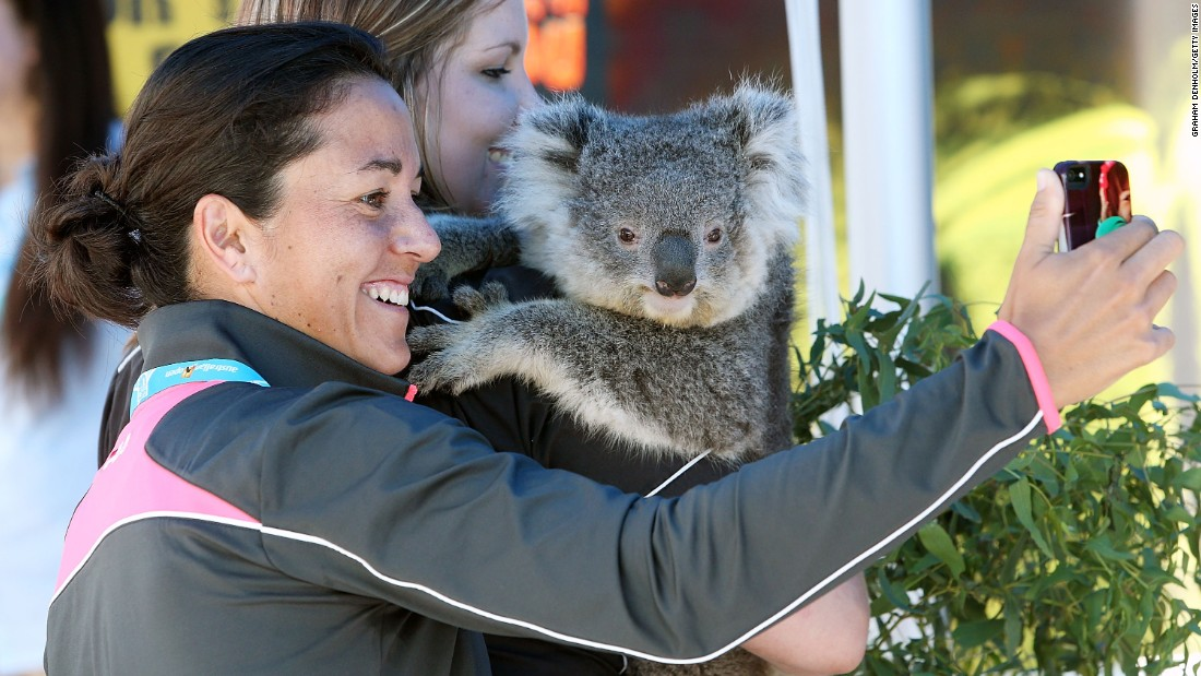 Tennis player Silvia Soler-Espinosa, in Melbourne for the Australian Open, takes a selfie with a koala on Thursday, January 22.