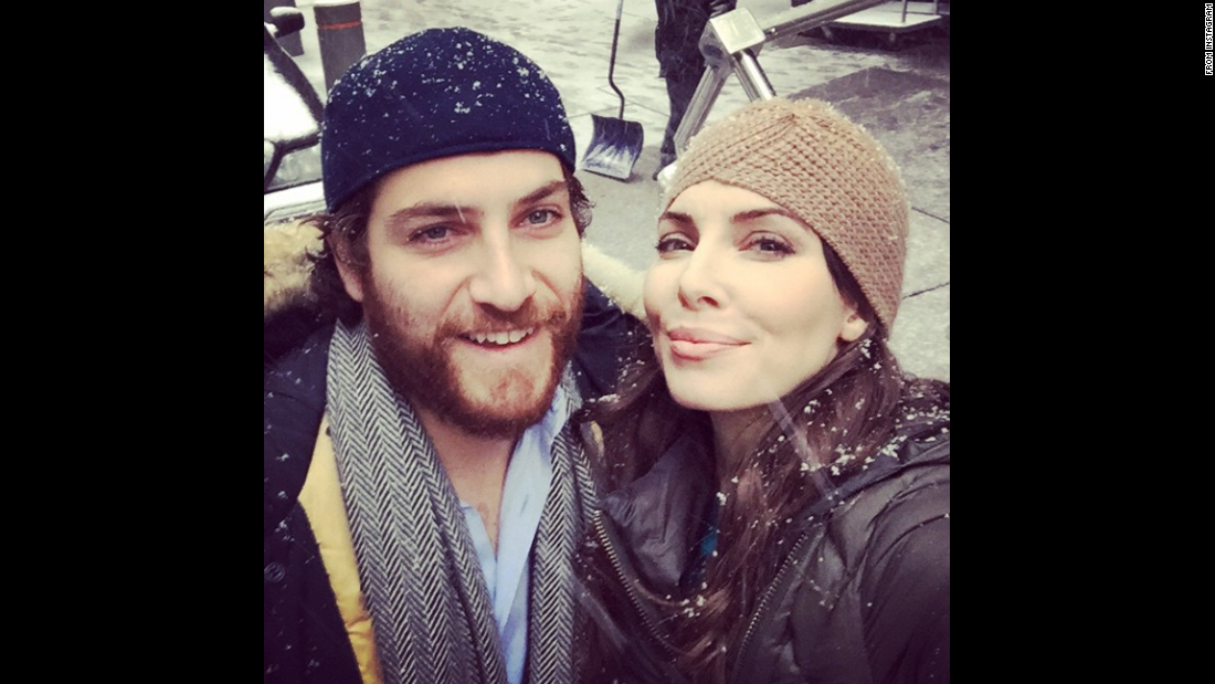 "Comedian Whitney Cummings takes a ""snow selfie"" with actor Adam Pally on Monday, January 26. ""We are both hosting the Late Late show this week so this is us pretending not to be competitive,"" <a href=""http://instagram.com/p/yVCYX4kmb3/?modal=true"" target=""_blank"">she wrote on Instagram.</a>"