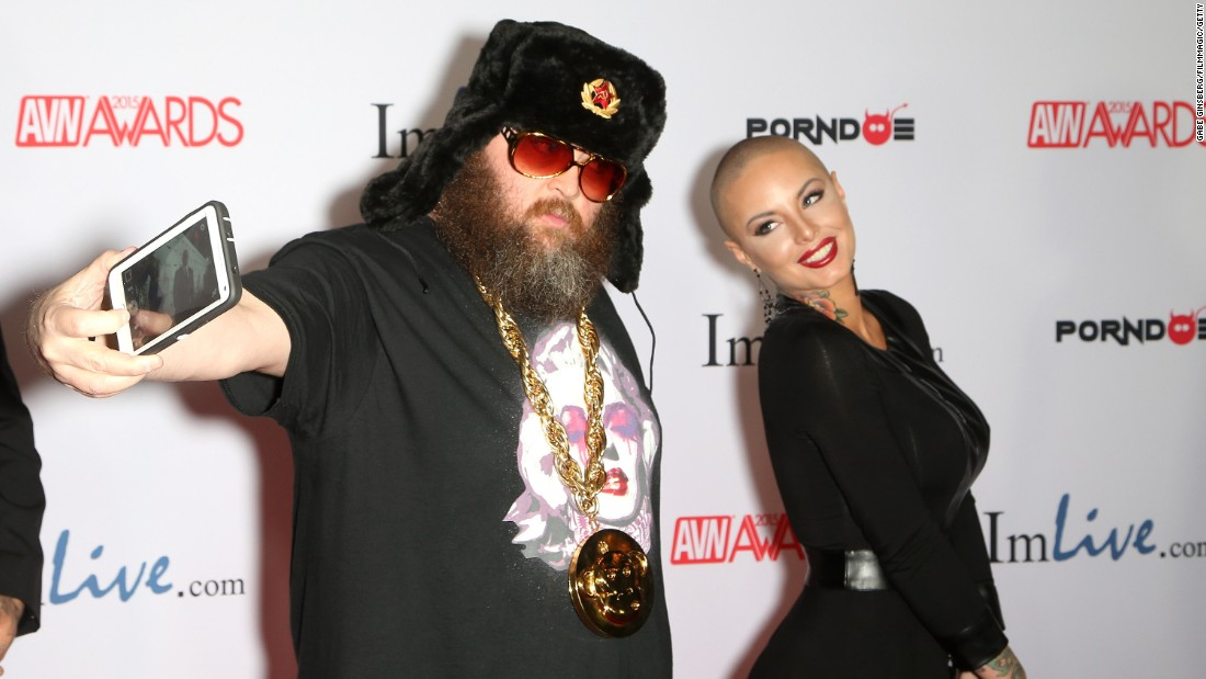 Adult-film director Ivan takes a photo with adult-film actress Christy Mack as they arrive for the Adult Video News Awards, which were held Saturday, January 24, in Las Vegas.