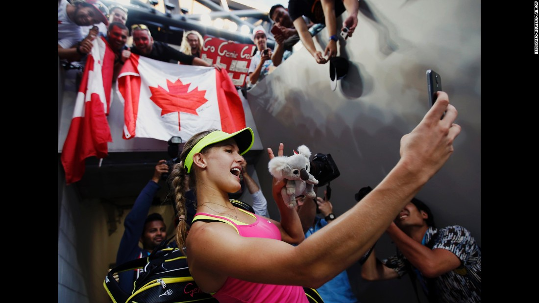 "Tennis player Eugenie Bouchard uses a fan's phone to take a selfie after she won her second-round match at the Australian Open on Wednesday, January 21. <a href=""http://www.cnn.com/2015/01/21/living/gallery/look-at-me-selfies-0121/index.html"" target=""_blank"">See 21 selfies from last week</a>"