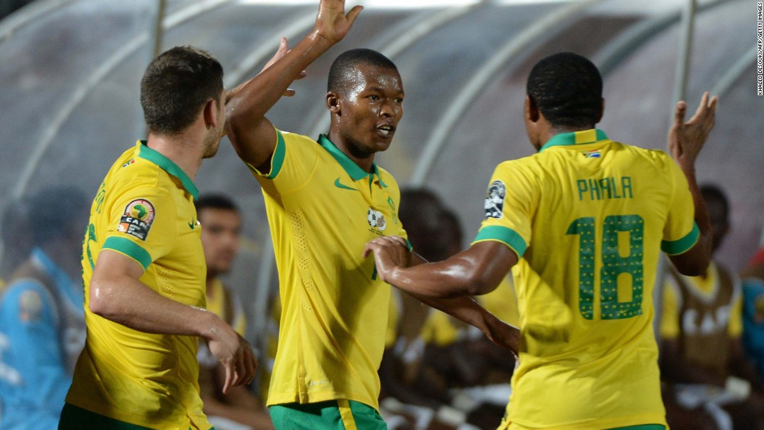 Mandla Masango (center) celebrates with teammates after firing South Africa into the lead of the AFCON Group C fixture with Ghana.