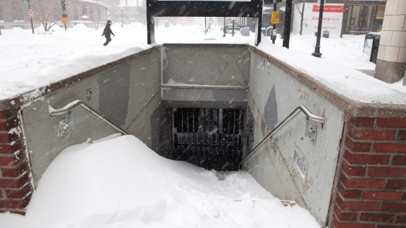 Snow piles up at the entrance of a closed T station in Boston on January 27. The city's public transit system was set to reopen the next day.