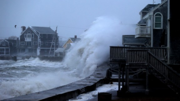 A wave slams into a sea wall in Scituate as evening high tide approaches on January 27.