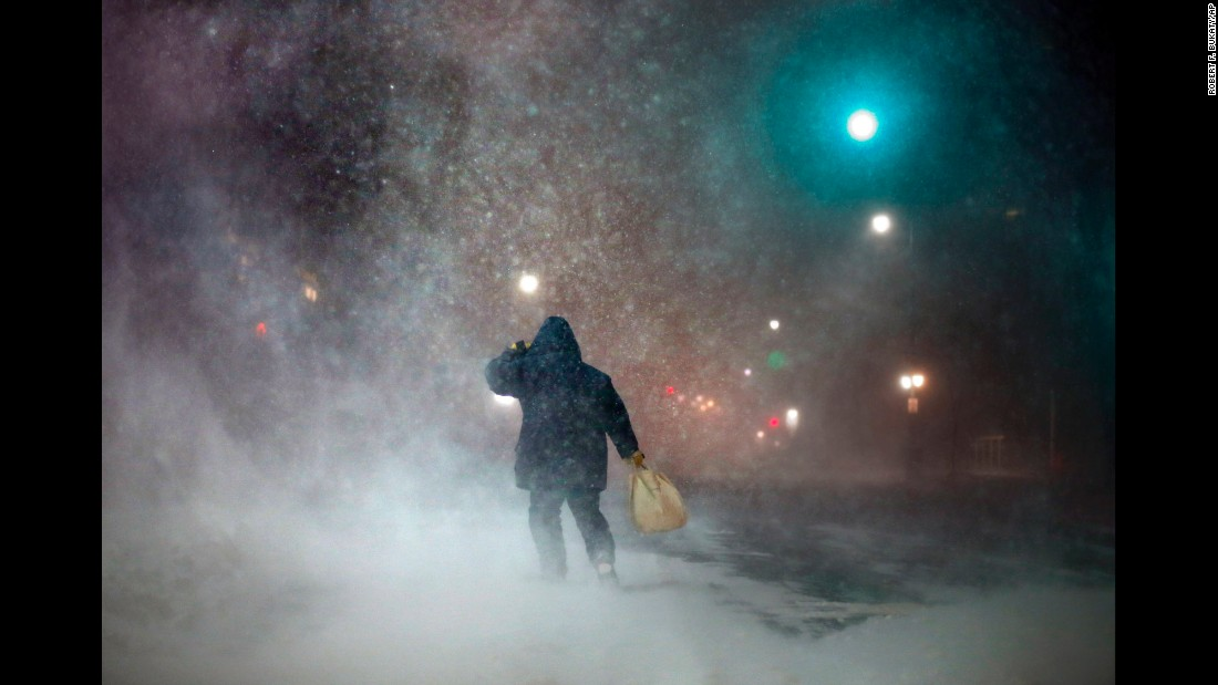 A man battles strong winds in Portland, Maine, on Tuesday, January 27.
