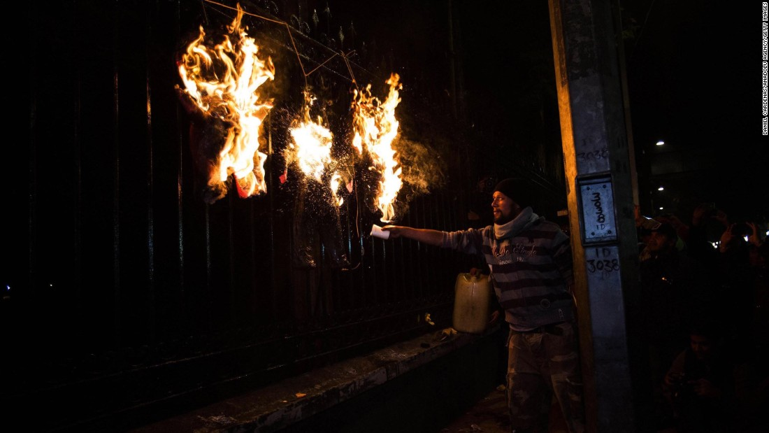 A man burns an effigy of Mexican President Enrique Pena Nieto during a protest in Mexico City on Wednesday, December 31.