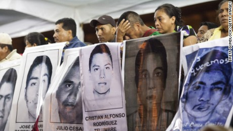 Families of 43 missing students from Guerrero State in Mexico protest the government and demand answers of the missing students on November 5, 2014 in Mexico City, Mexico. The students have been missing since September 26, 2014 and are from the Atyotzinapa teaching college in Iguala, Mexico. (Photo by Brett Gundlock/Getty Images)