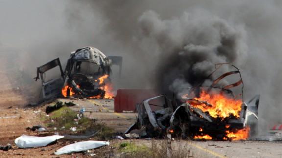 Israeli military vehicles are seen burning in the Shebaa farms an occupied area along the Israeli-Lebanese border near Ghajar village, on January 28, 2015