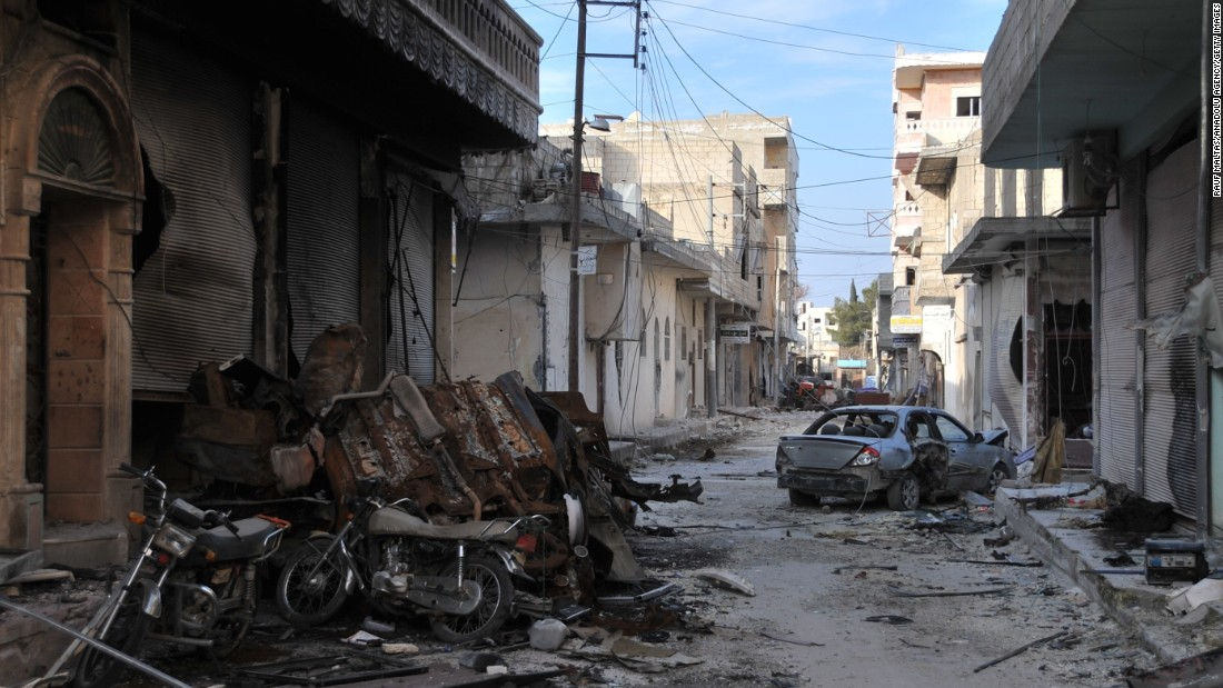 Collapsed buildings are seen in Kobani on January 27 after Kurdish forces took control of the town from ISIS.