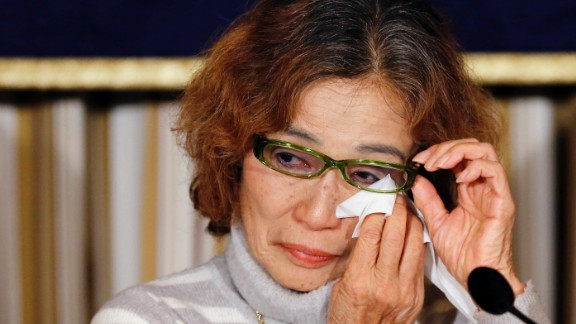 Junko Ishido, mother of Japanese journalist Kenji Goto, reacts during a news conference in Tokyo on Friday, January 23. ISIS would later kill Goto and another Japanese hostage, Haruna Yukawa.