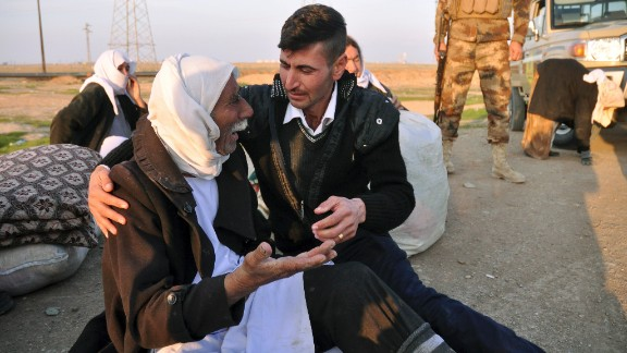 An elderly Yazidi man arrives in Kirkuk after being released by ISIS on Saturday, January 17. The militant group released about 200 Yazidis who were held captive for five months in Iraq. Almost all of the freed prisoners were in poor health and bore signs of abuse and neglect, Kurdish officials said.