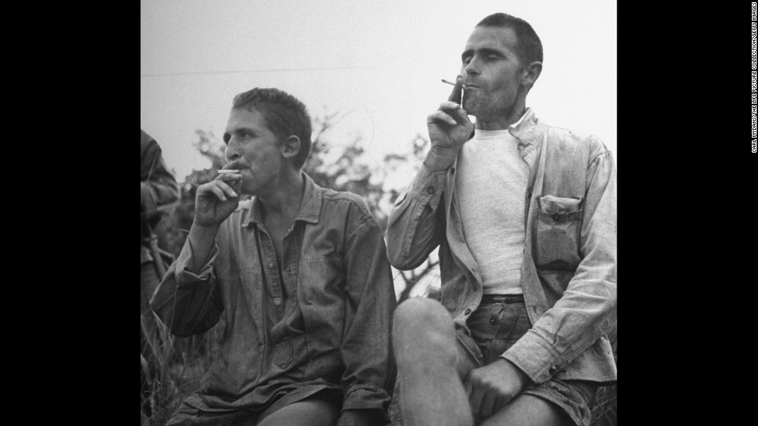 Allied POWs smoke cigarettes for the first time in three years.
