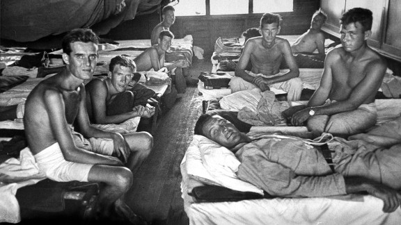 Allied POWs rescued from the Japanese prison camp receive medical treatment.