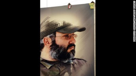 A banner shows assasinated former Hezbollah military wing leader Imad Mughniyeh.