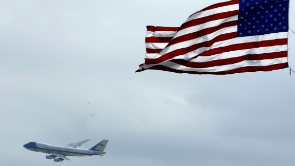 Air Force One flies past an American flag on its way into Daytona Beach, Florida, in 2004. The U.S. Air Force announced Wednesday, January 28, that a customized military version of Boeing