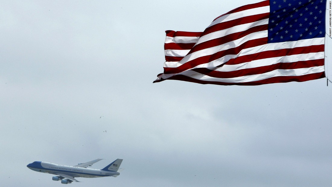 Air Force One flies past an American flag on its way into Daytona Beach, Florida, in 2004. The U.S. Air Force announced Wednesday, January 28, that a customized military version of Boeing's 747-8 will serve as Air Force One for future Presidents. Click through to see the different airplanes that have served as the President's transportation over the years.