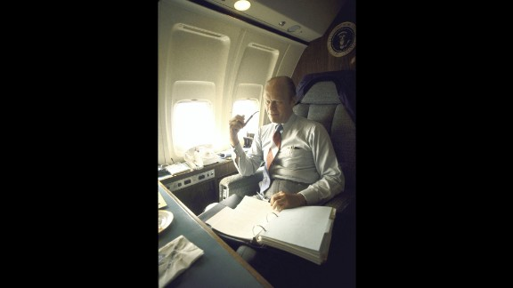 President Gerald Ford works while aboard Air Force One in 1974.