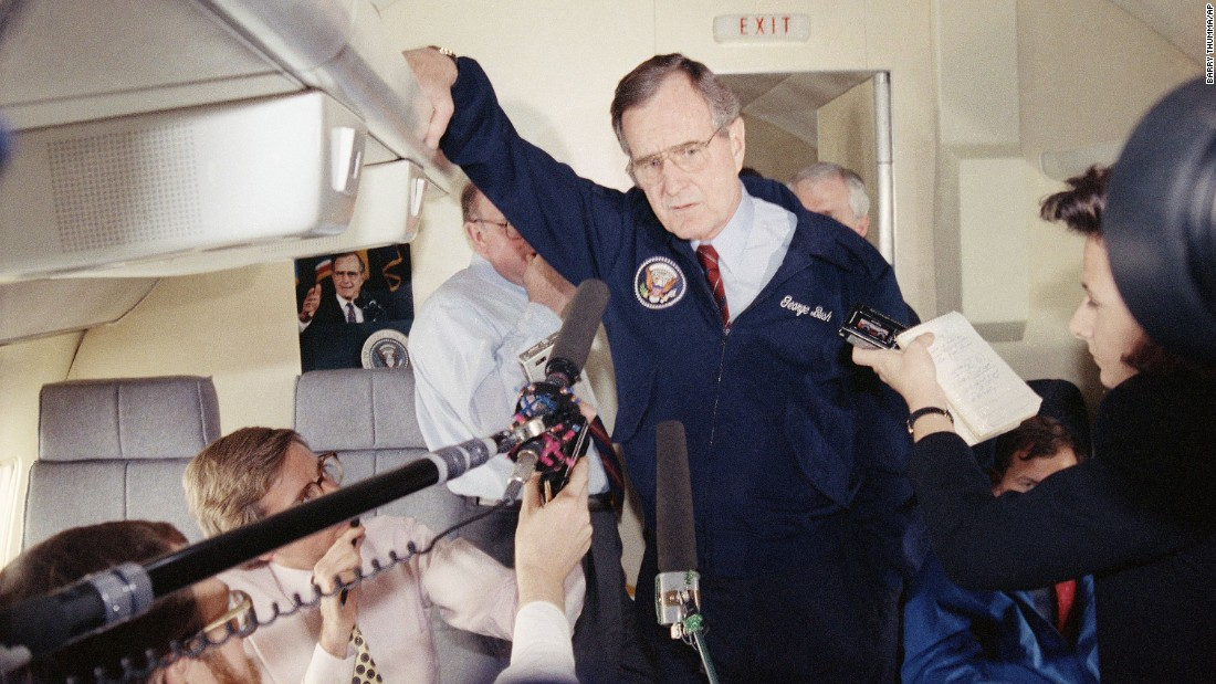 President George H. W. Bush talks with reporters aboard Air Force One in 1990. The Boeing VC-25 -- a military version of the 747-200B -- served as Air Force One for Bush as well as Presidents Bill Clinton, George W. Bush and Barack Obama.