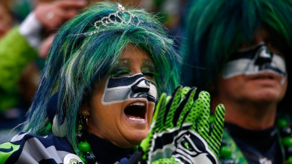 A Seattle Seahawks fan gets dressed up to support her team. The Seahawks are also the number one seed in their respective conference and are the first team to play in a consecutive Super Bowl event since 2005.