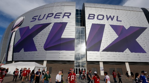 Fans outside the University of Phoenix stadium in Glendale, Arizona where Super Bowl XLIX will kick off. This is the second time the stadium has hosted the Super Bowl since 2008 when the New York Giants defeated the New England Patriots.