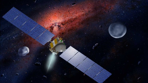 Artist concept showing the Dawn spacecraft with Ceres and Vesta.