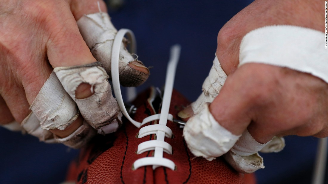 A worker installs laces on a football Monday, January 26, at the Wilson Sporting Goods factory in Ada, Ohio. Every ball that has appeared in a Super Bowl has been made at the factory.