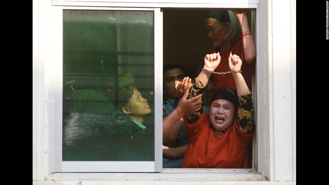 "Housing rights activists shout from a window as they arrive to an appeals court in Phnom Penh, Cambodia, on Monday, January 26. Their verdicts were upheld, according to the <a href=""http://www.phnompenhpost.com/national/b-kak-protest-convictions-upheld-appeal"" target=""_blank"">Phnom Penh Post</a>, and they face more jail time for ""intentionally inciting violence against a public authority."" <a href=""http://www.amnesty.org/en/news/cambodia-free-women-protesters-and-buddhist-monk-jailed-after-summary-trials-2015-01-21"" target=""_blank"">Amnesty International </a>says that when the activists were arrested in November, they were peacefully protesting what they felt was inaction over flooding in their neighborhood."