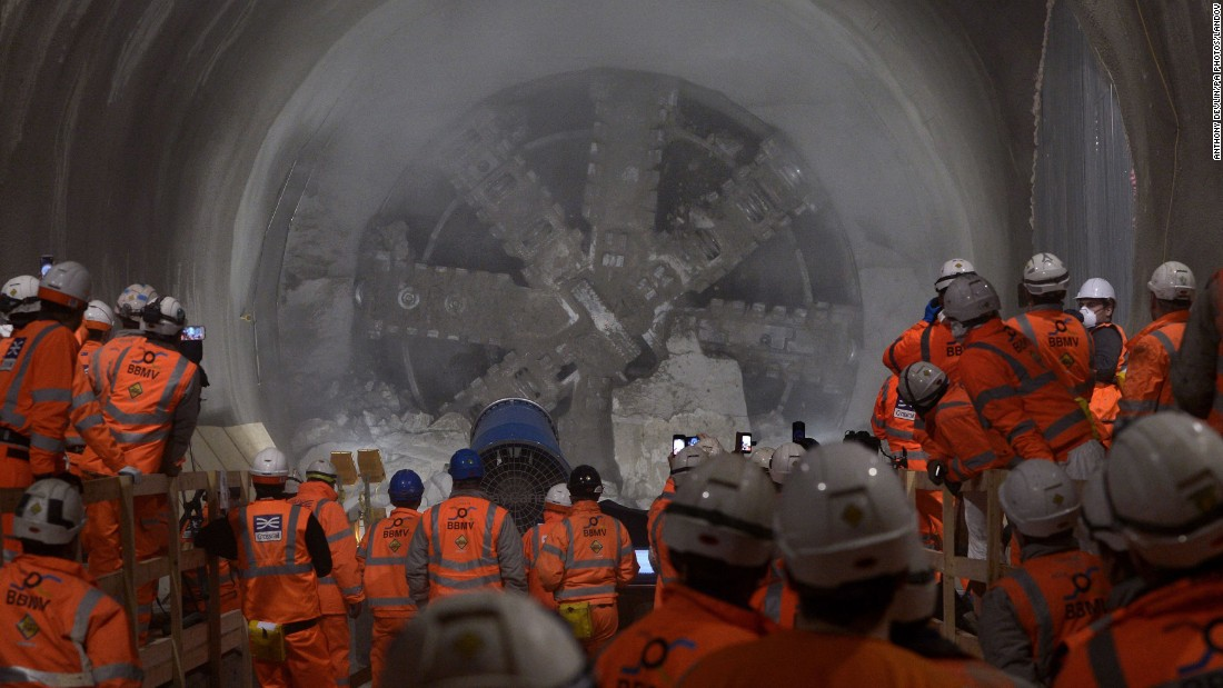 Workers in London watch a tunnel-boring machine as it breaks through the east end of Crossrail's Liverpool Street station on Thursday, January 29.