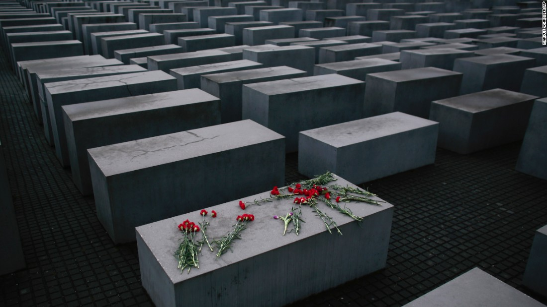 Flowers lie on a concrete slab at the Holocaust Memorial in Berlin to mark International Holocaust Remembrance Day on Tuesday, January 27.