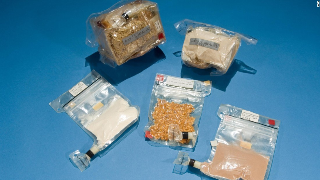 "Food served on the Apollo missions (1968-1972). Seen at the bottom is the famous ""spoon bowl,"" an advance that meant astronauts no longer had to eat food directly from tubes. Food was rehydrated and warmed with a hot water gun and eaten with real utensils. Food didn't float off the spoon as some had feared, as the food's moisture made it stick to the spoon."