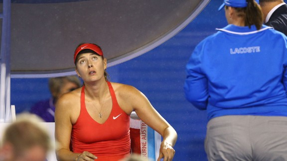 There was a 12-minute delay in the first set due to rain.