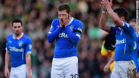 Dejected Rangers players troop off Hampden after losing 2-0 to Celtic in the Scottish League Cup semifinal.