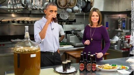 President Barack Obama swigs some beer before the Super Bowl with NBC's Savannah Guthrie.