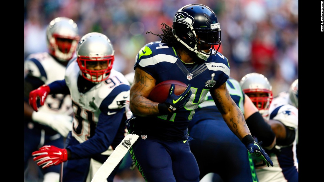 Lynch runs the ball in the first quarter.