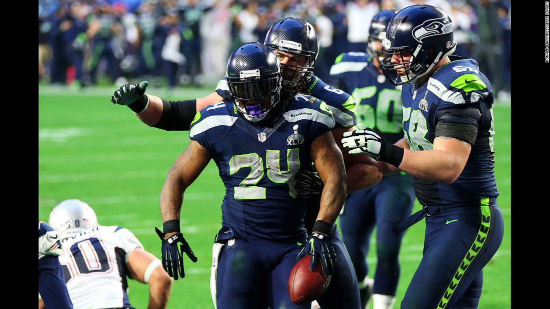 Seattle running back Marshawn Lynch (No. 24) reacts after scoring a second-quarter touchdown. The game was 7-7 after the extra point.