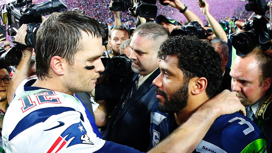 Brady is congratulated by Seahawks quarterback Russell Wilson. Wilson and the Seahawks won the Super Bowl last year.
