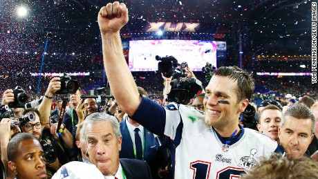 Caption:GLENDALE, AZ - FEBRUARY 01: Tom Brady #12 of the New England Patriots celebrates after defeating the Seattle Seahawks 28-24 during Super Bowl XLIX at University of Phoenix Stadium on February 1, 2015 in Glendale, Arizona. (Photo by Tom Pennington/Getty Images)