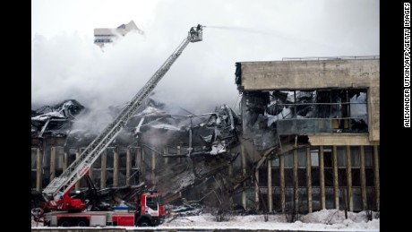 Firefighters battle a blaze at the Institute for Research Information on Social Sciences library in Moscow.