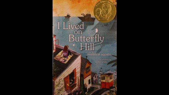 """""""I Lived on Butterfly Hill"""" is the 2015 Pura Belpré Author Award winner. The book is written by Marjorie Agosín and illustrated by Lee White."""