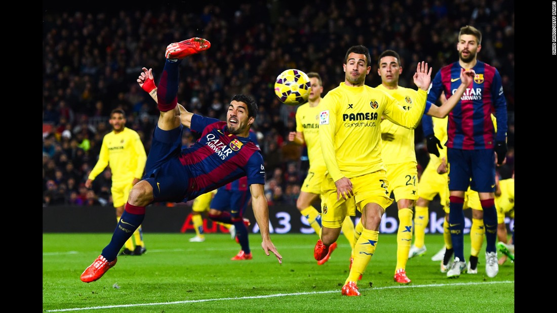 Barcelona forward Luis Suarez performs an overhead kick during a Spanish league match against Villarreal on Sunday, February 1. Barcelona won 3-2 for its eighth straight victory.