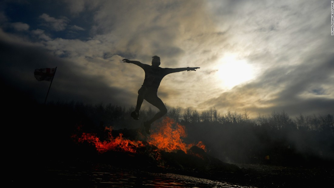 A competitor jumps over fire during the annual Tough Guy Challenge race held Sunday, February 1, in Telford, England.