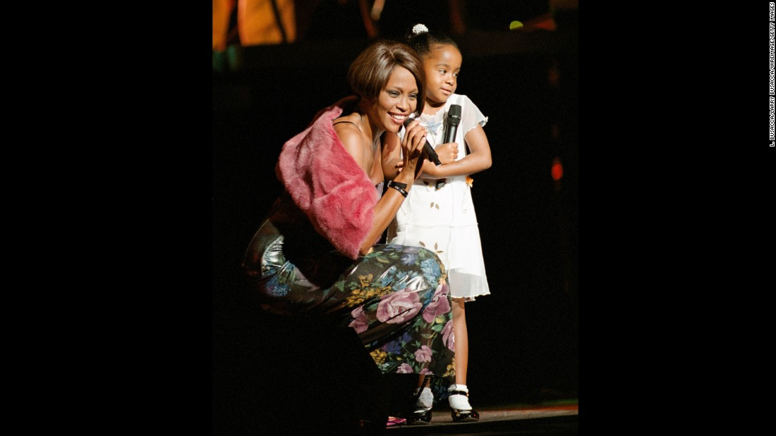 Bobbi Kristina, 6, appears with her mom on stage at a 1999 concert in New York.