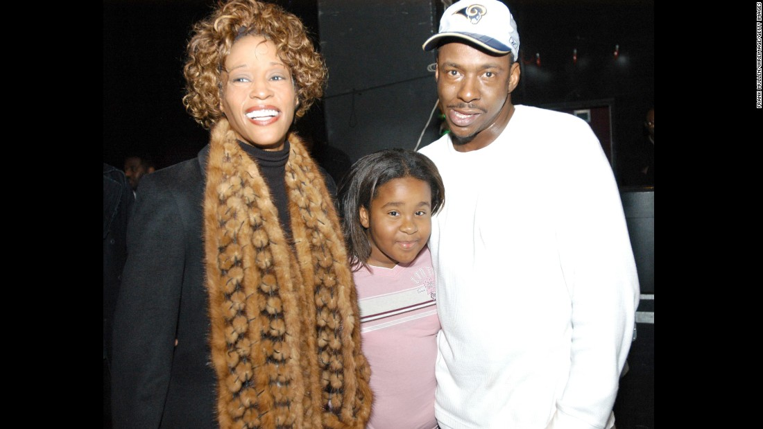 Another photo of Bobbi Kristina with her parents, who separated in 2006 and divorced the next year.