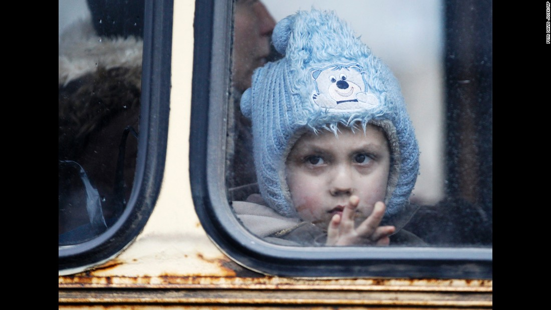 A child waits on a bus to leave Debaltseve on Tuesday, February 3, after increased fighting in the region.